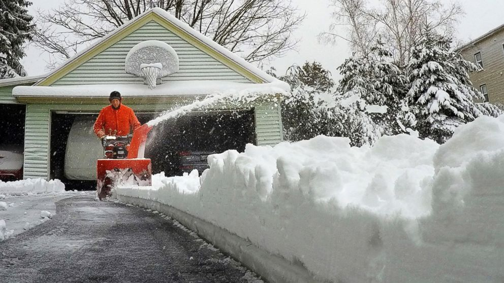 A Portland, Maine resident uses a snowblower to clear snow during a nor'easter, March 8, 2018.