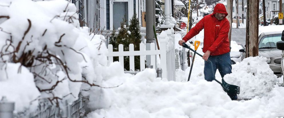 PHOTO: Albert Rodriguez shovels a sidewalk in Haverhill, Mass., March 8, 2018.