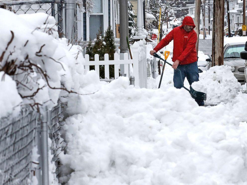 PHOTO: Albert Rodriguez shovels a sidewalk in Haverhill, Mass., March 8, 2018.