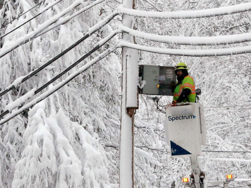 PHOTO: A lineman works to restore power amid limbs sagging with heavy wet snow after a snowstorm, March 8, 2018, in Northborough, Mass.