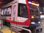 Video shows woman caught in door, dragged onto train tracks