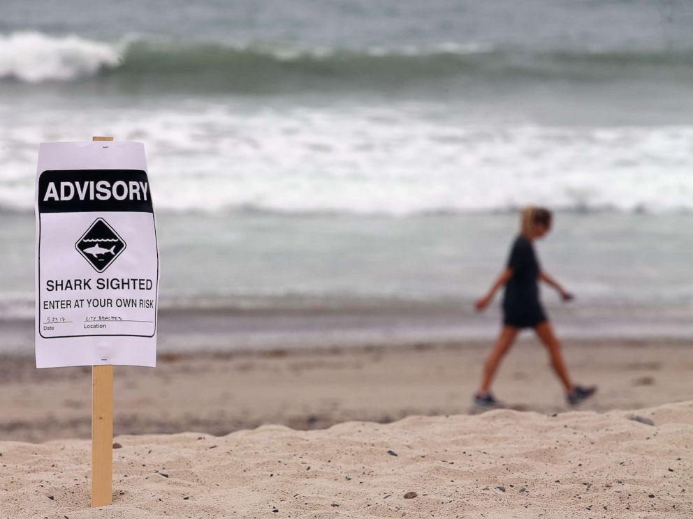 PHOTO: Warning signs are placed along the beach to warn swimmers and surfers of recent shark sightings in San Clemente, Calif., May 23, 2017.