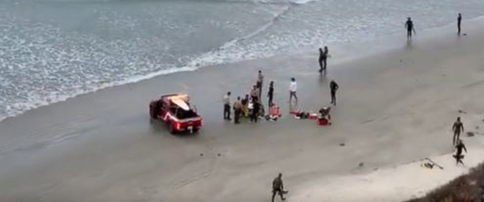 PHOTO: Emergency personnel at the scene where a 13 year old boy was airlifted after being attacked by a shark while fishing for lobsters off a beach near San Diego.