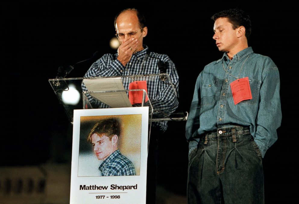 PHOTO: Matthew Shepards friends Walter Boulden and Alex Trout, from left, get emotional as they speak during a national vigil for Shepard at the steps of the U.S. Capitol, Oct. 14, 1998.
