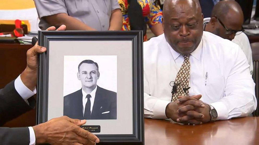 PHOTO: On June 13, 2019, Wake County Sheriff Gerald Baker removes a photo of the man who was the Wake County Sheriff at the time of the 1952 attack.