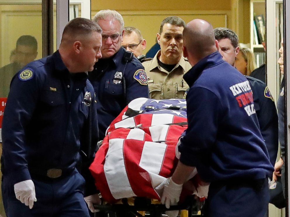 PHOTO: The body of a Kittitas County Sheriffs deputy is draped with a U.S. flag as it is carried out of Kittitas Valley Healthcare Hospital, March 20, 2019, in Ellensburg, Wash.
