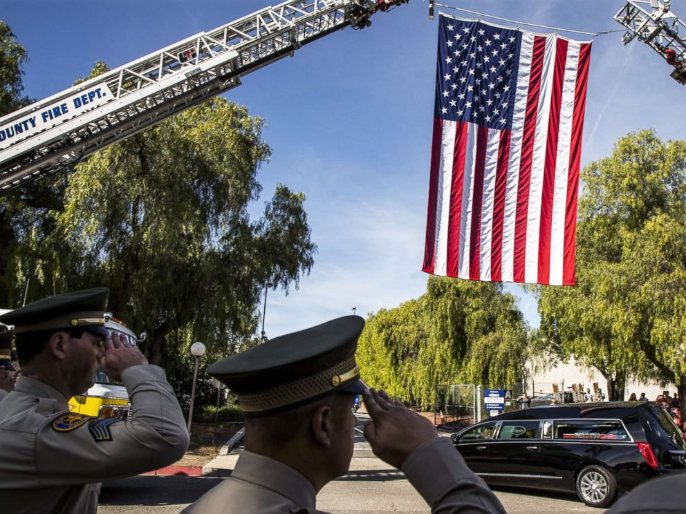 PHOTO: A hearse carrying the coffin of Ventura County Sheriff Sgt. Ron Helus is driven into The Calvary Community Church for his memorial service, Nov. 15, 2018, in Westlake, Calif.