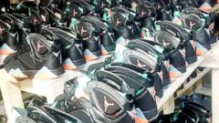 8836b9219e 5 people charged with trafficking $73 million in counterfeit Nike Air  Jordans: Police