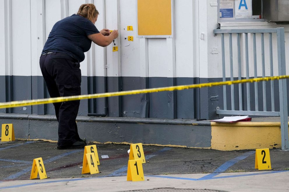 PHOTO: LAPD crime investigators collect evidence at one of the scenes of a shooting, a Shell gas station in the North Hollywood section of Los Angeles on Thursday, July 25, 2019.