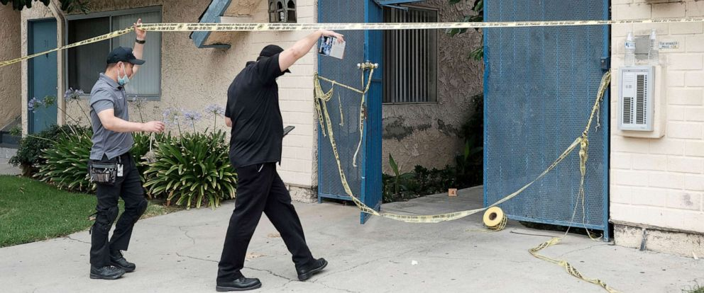 PHOTO: Investigators walk into an apartment where a shooting occurred in the Canoga Park area of Los Angeles on Thursday, July 25, 2019.