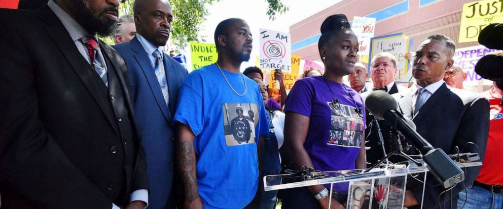 PHOTO: Delisha Searcy, mother of DeVon Bailey, at podium, speaks at a news conference in front of the Colorado Springs Police Department Police Operations Center, Tuesday, Aug. 13, 2019, in Colorado Springs, Colo.