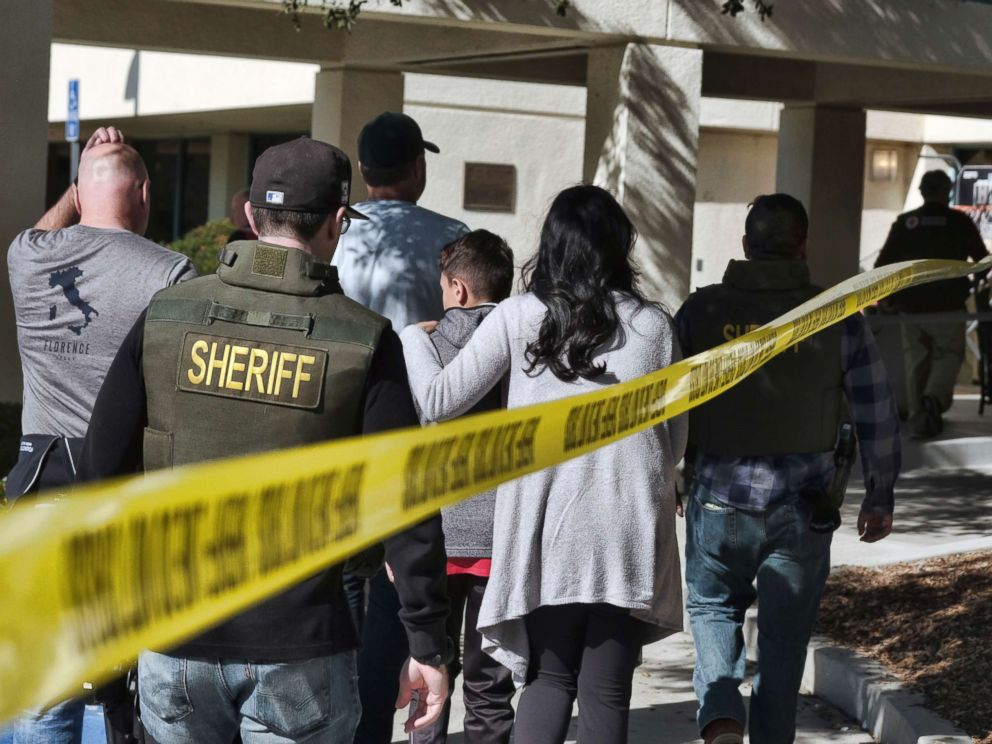 PHOTO: Family members are led into the Thousand Oaks Teen Center where families have gathered after a deadly shooting at a bar in Thousand Oaks, Calif., Nov. 8, 2018.