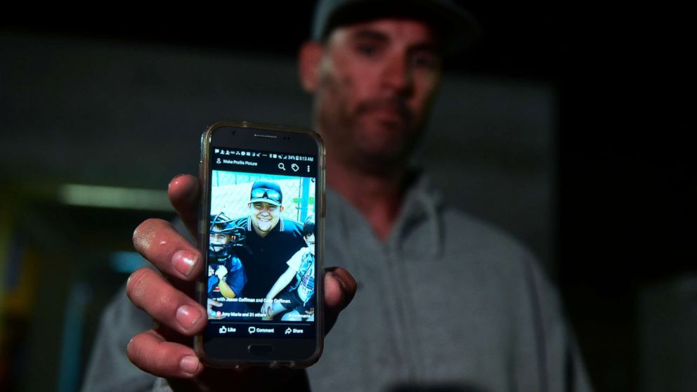 Jason Coffman displays a photo of his son Cody outside the Thousands Oaks Teene Center where he came hoping to find his son who was at the Borderline Bar and Grill in Thousand Oaks, Calif., Nov.8, 2018.