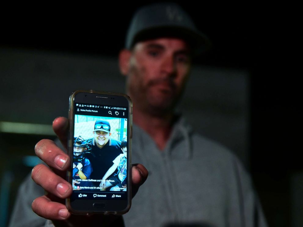 PHOTO: Jason Coffman displays a photo of his son Cody outside the Thousands Oaks Teene Center where he came hoping to find his son who was at the Borderline Bar and Grill in Thousand Oaks, Calif., Nov.8, 2018.