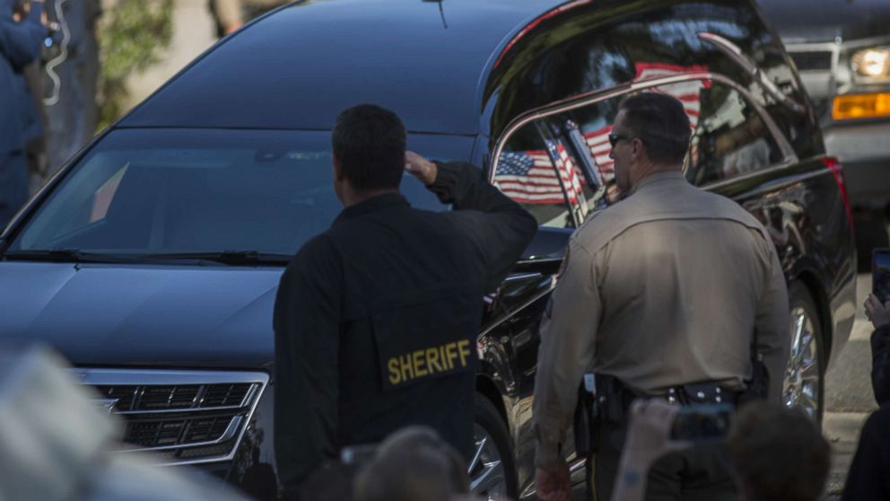 The procession carrying the body of Ventura County Sheriffs Sgt. Ron Helus, who was killed in a mass shooting at the Borderline Bar and Grill, leaves Los Robles Hospital, Nov. 8, 2018, in Thousand Oaks, Calif.