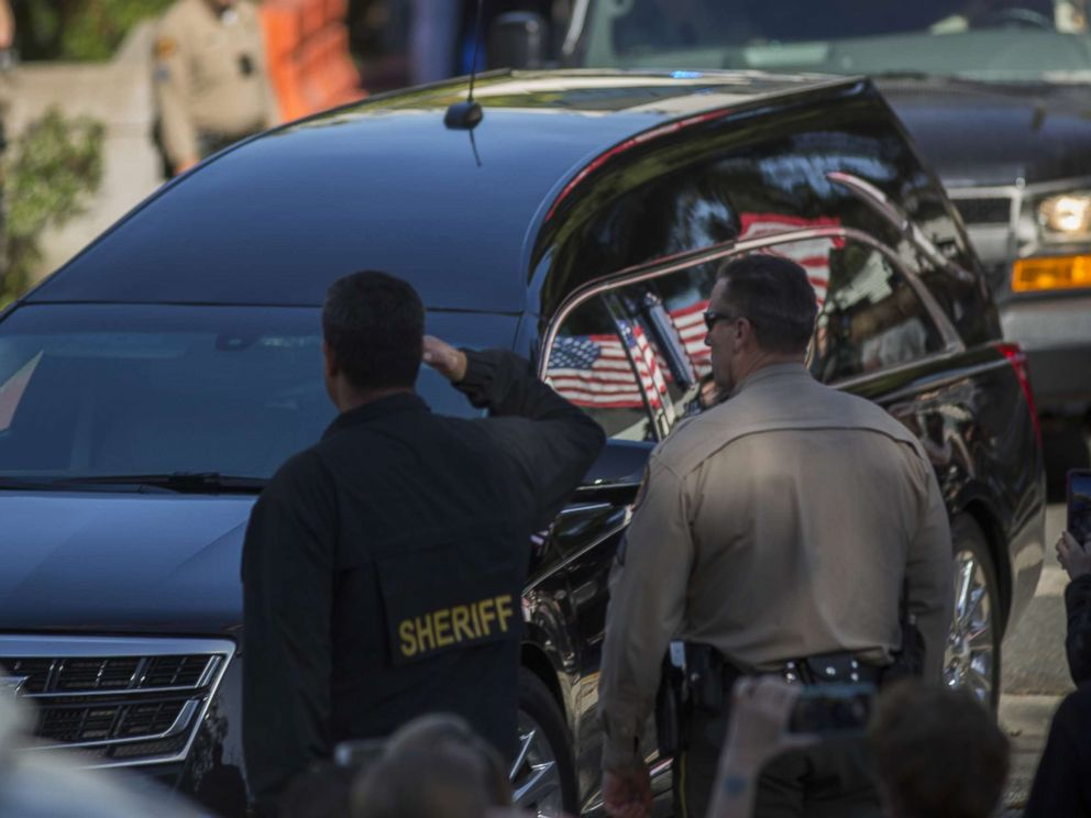 PHOTO: The procession carrying the body of Ventura County Sheriffs Sgt. Ron Helus, who was killed in a mass shooting at the Borderline Bar and Grill, leaves Los Robles Hospital, Nov. 8, 2018, in Thousand Oaks, Calif.