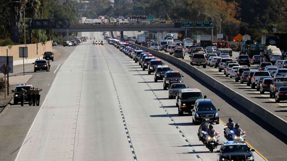 A procession for the body of Sergeant Ron Helus, who died in a shooting incident at a Thousand Oaks bar,  drives down Ventura Highway 101 in Thousand Oaks, Calif., Nov. 8, 2018.