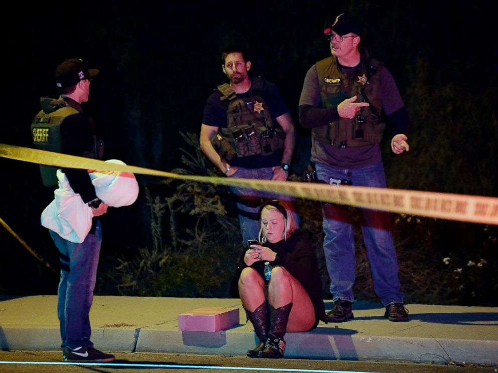 PHOTO: Sheriffs deputies speak to a potential witness as they stand near the scene where a gunman opened fire, Nov. 8, 2018, in Thousand Oaks, Calif.