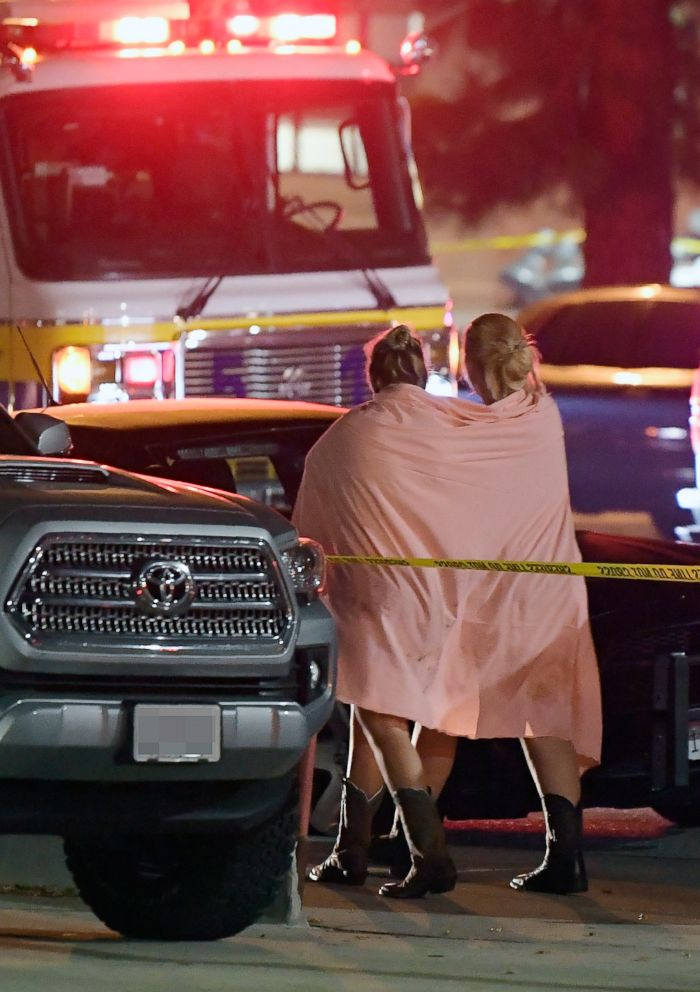 PHOTO: People walk away from the scene, Nov. 8, 2018, in Thousand Oaks, Calif., where a gunman opened fire Wednesday inside a country dance bar crowded with hundreds of people on college night.