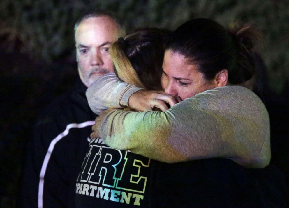 PHOTO: A woman who fled the Borderline Bar and Grill is hugged by relatives in Thousand Oaks, Calif. Nov. 8, 2018.