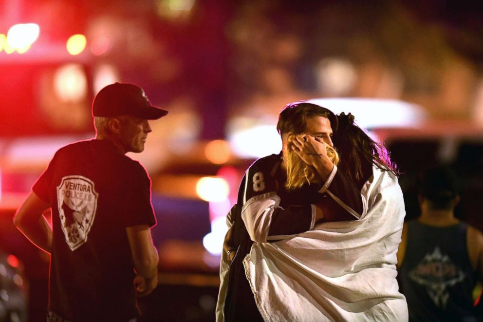 PHOTO: People comfort each other, Nov. 8, 2018, after a mass shooting at the Borderline Bar & Grill in Thousand Oaks late Wednesday night.