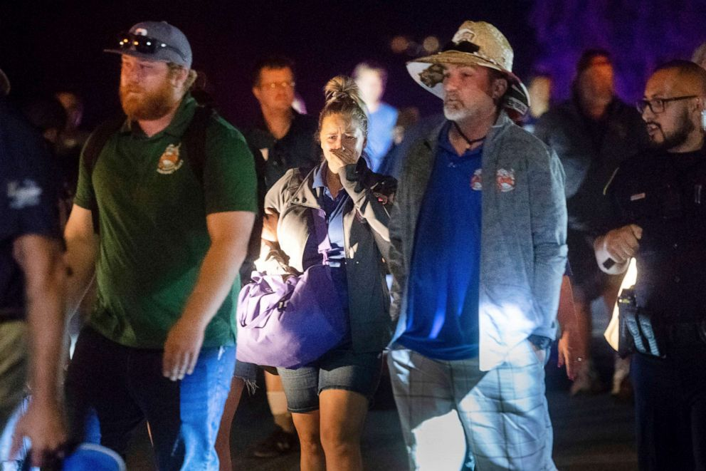PHOTO: Police officers escort people from Christmas Hill Park following a deadly shooting during the Gilroy Garlic Festival, in Gilroy, Calif., July 28, 2019
