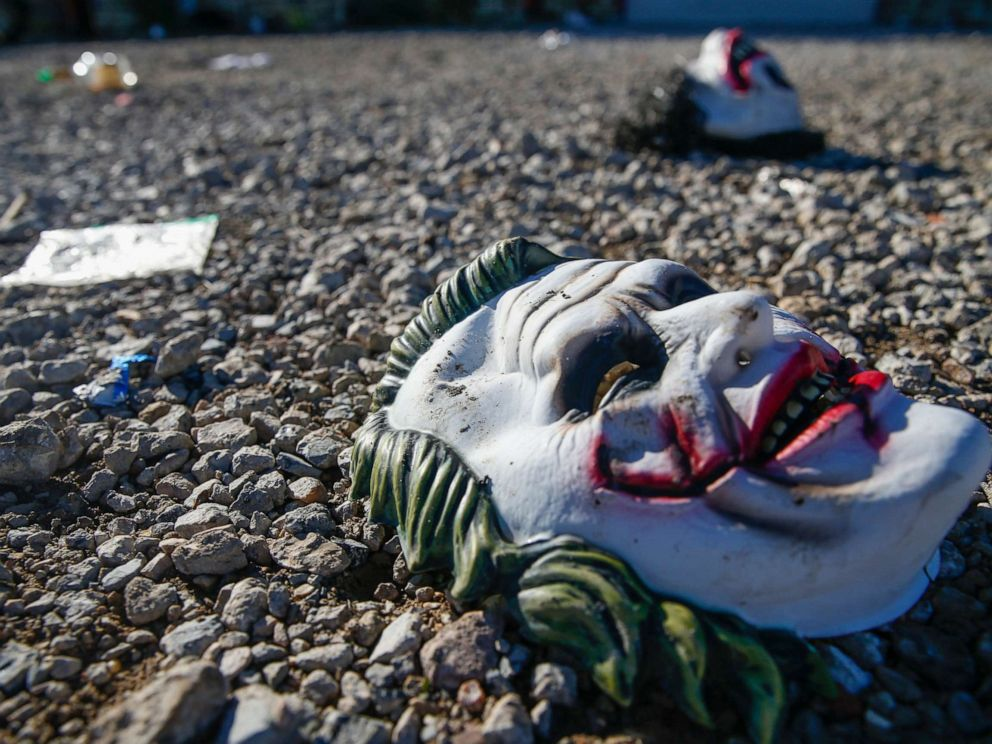 PHOTO: Halloween masks litter the ground amongst signs of chaos at the scene of a deadly shooting in Greenville, Texas, on Oct. 27, 2019.