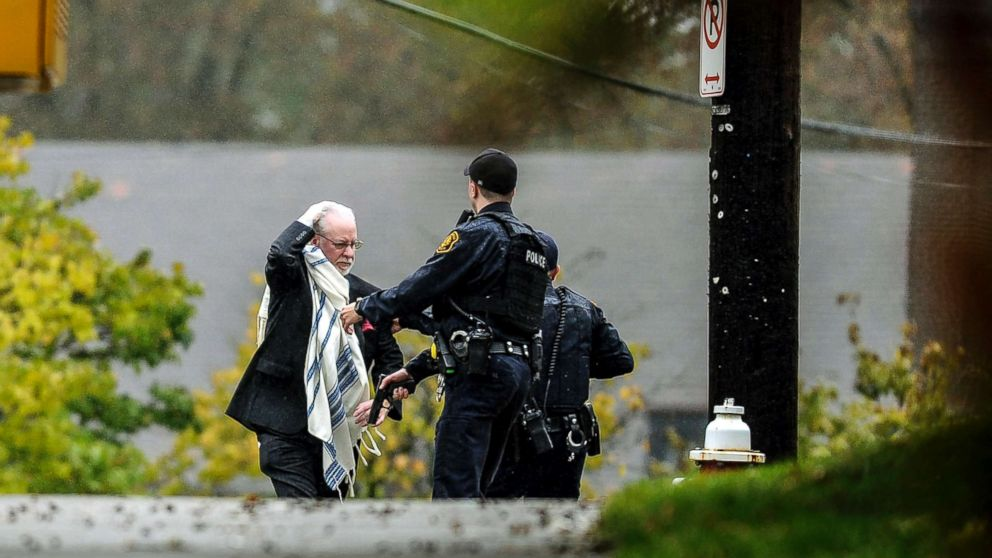 A man is escorted out of the Tree of Life Congregation by police following a shooting at the Pittsburg synagogue, Oct. 27, 2018.