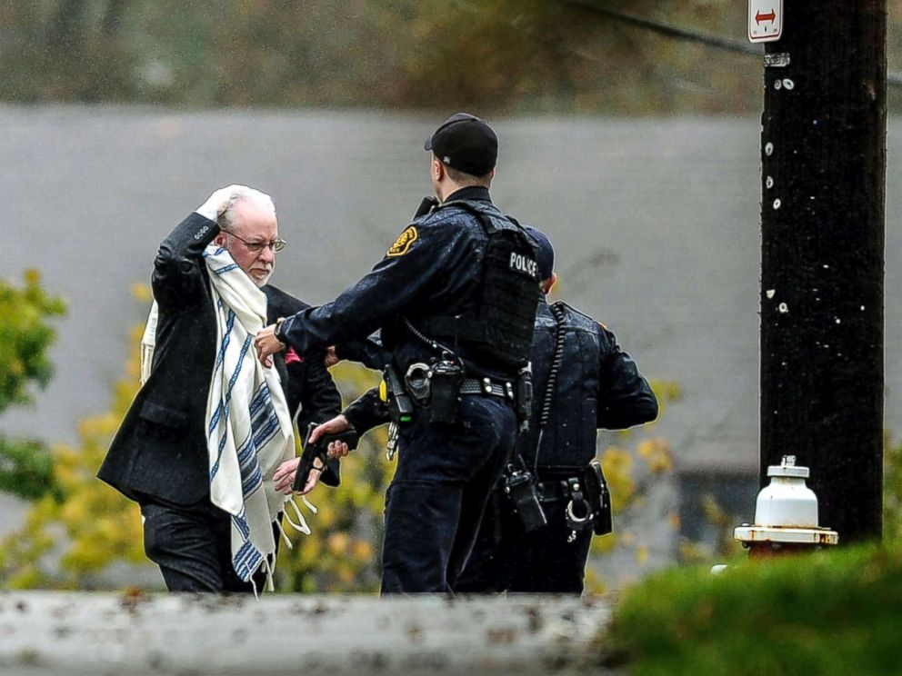 PHOTO: A man is escorted out of the Tree of Life Congregation by police following a shooting at the Pittsburg synagogue, Oct. 27, 2018.