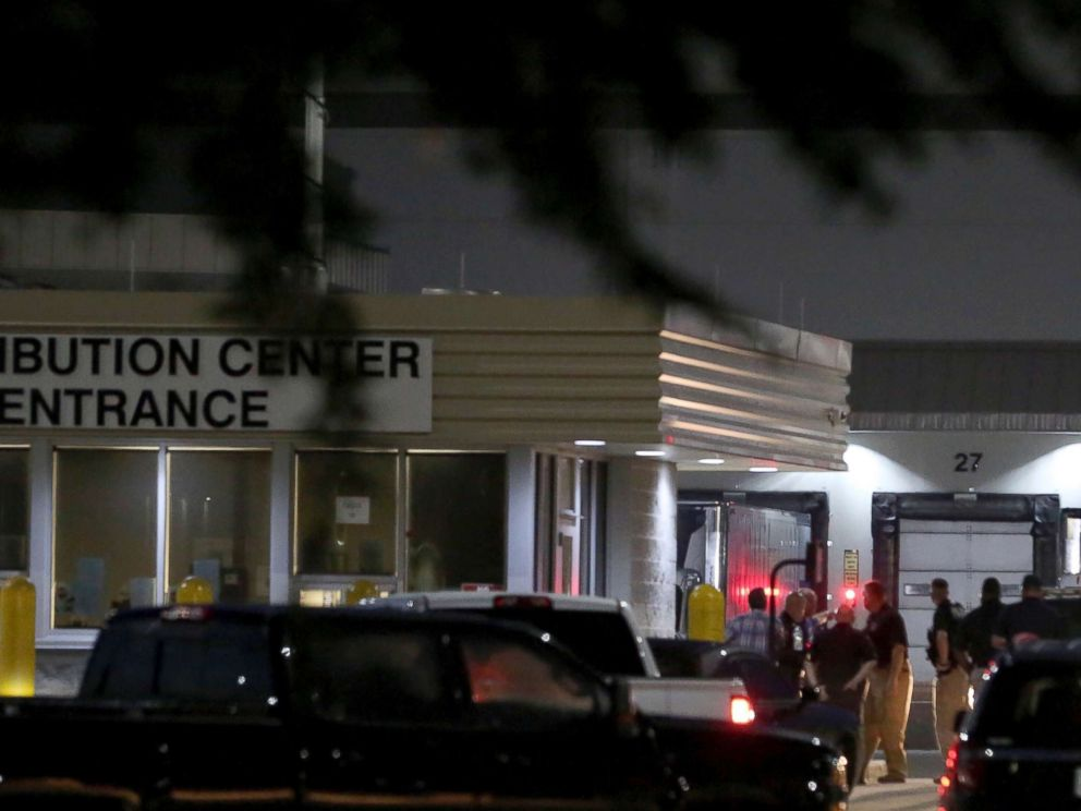 PHOTO: Authorities investigate the scene after a deadly shooting at Ben E. Keith distribution center, Aug. 20, 2018, in Missouri City, Texas.