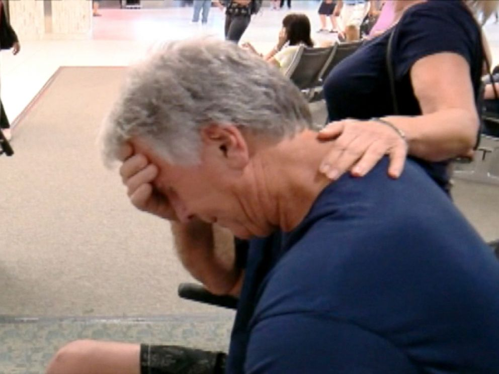 PHOTO: Edward Potter is overcome with emotion as he leaves Tampa International Airport.
