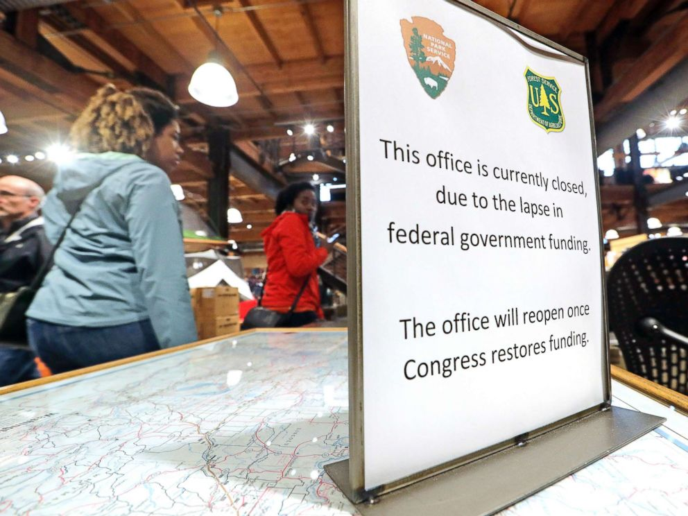 PHOTO: REI Co-op customers walk past an unstaffed ranger station kiosk, closed as part of the federal government shutdown, inside the flagship store in Seattle, Dec. 26, 2018.