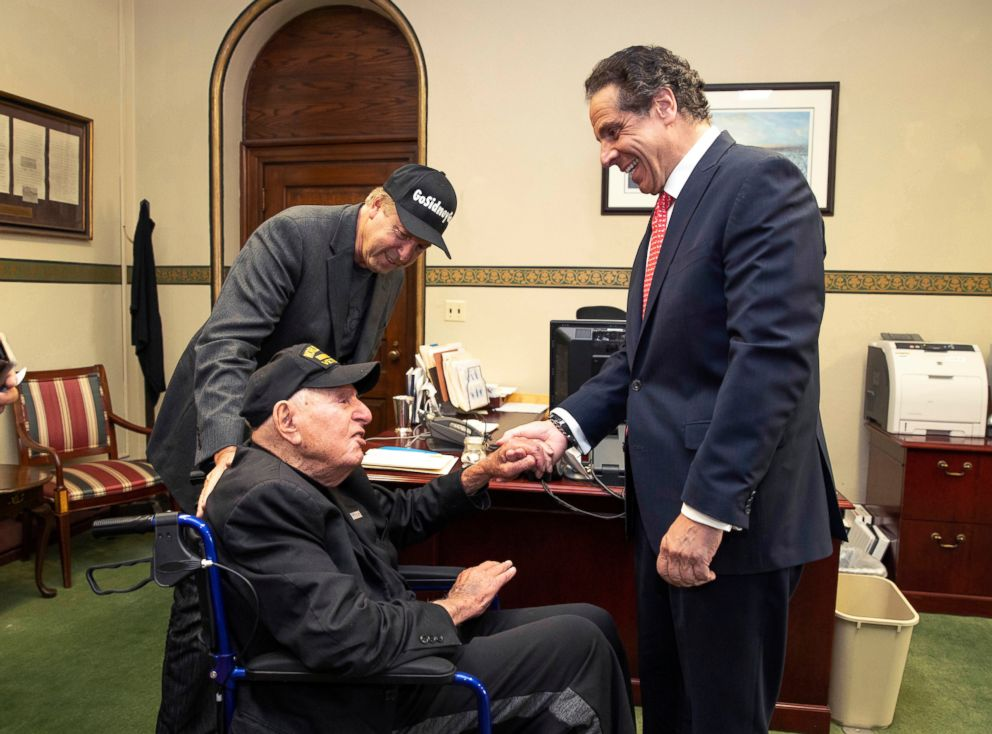 PHOTO: Governor Andrew M. Cuomo, right, shakes hands with World War II veteran Sidney Walton at the Capitol in Albany, N.Y., May 18, 2018.