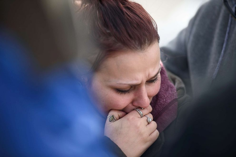PHOTO: Sierra Kolarik, the sister of Chelsie Cline, one of the victims in a mass shooting at Eds Car Wash, is comforted, Jan. 28, 2018, in Melcroft, Pa.
