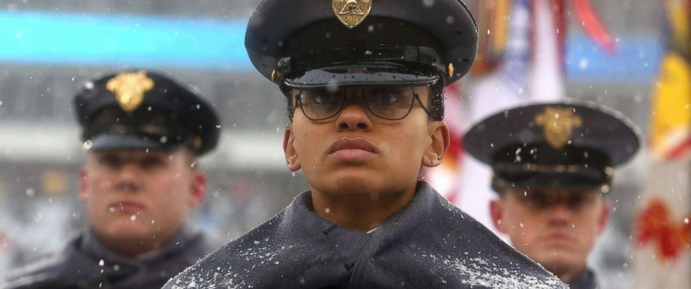 """PHOTO: First Captain Simone Askew stands in formation as she leads the """"march on"""" of Army Cadets before the 118th meeting of the annual Army Navy football game, Dec. 9, 2017 in Philadelphia."""