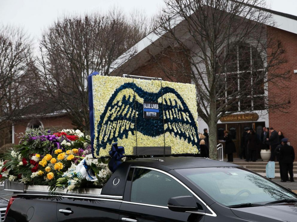 PHOTO: A limousine that is part of the funeral procession for Det. Brian Simonsen, is parked in front of the Church of St. Rosalie in Hampton Bays, N.Y., Feb. 20, 2019.
