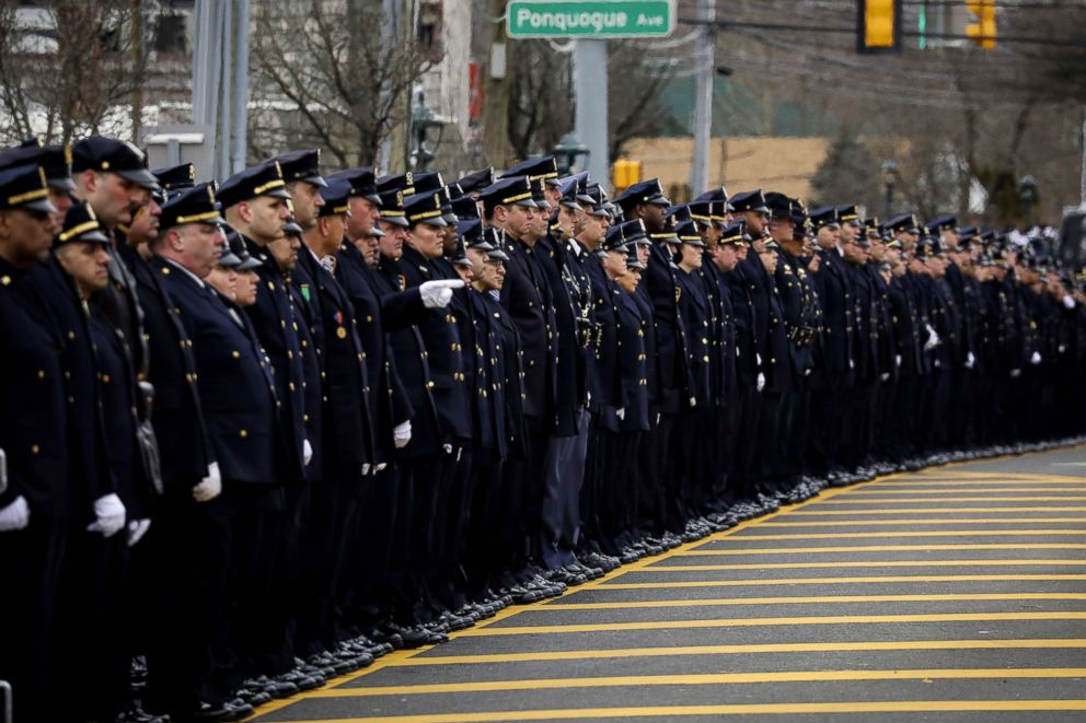 PHOTO: Officers line up on Montauk Highway as the funeral procession of fallen NYPD Detective Brian Simonsen leaves the Church of St. Rosalie, Feb. 20, 2019, in Hampton Bays, N.Y.