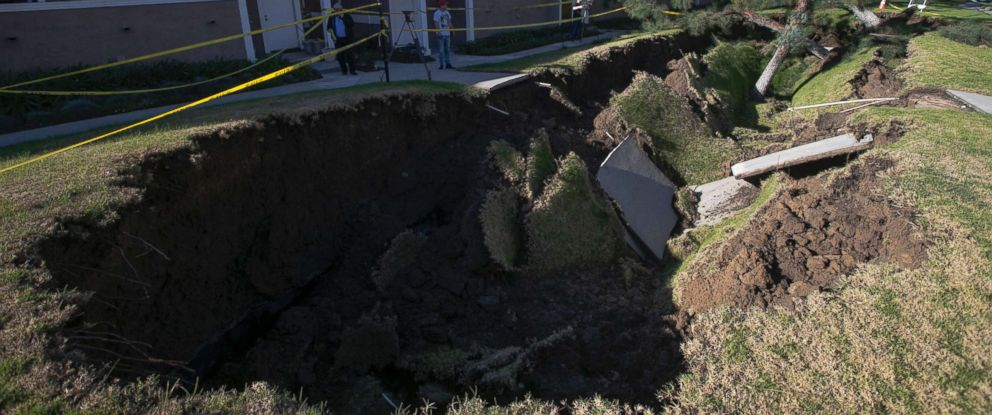 Massive Sinkhole Opens At Apartment Complex In Orange