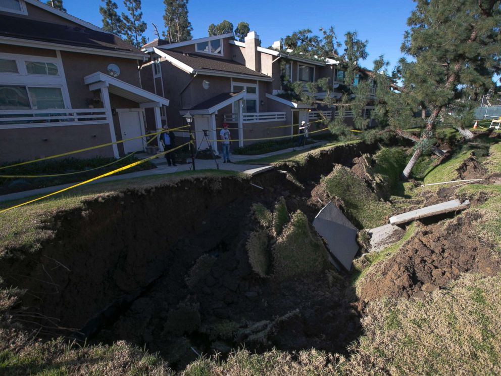 PHOTO: A sinkhole is seen in a condominium complex, Jan. 24, 2019, in La Habra, Calif. The hole is estimated to be about 80 feet long and 20 feet wide.