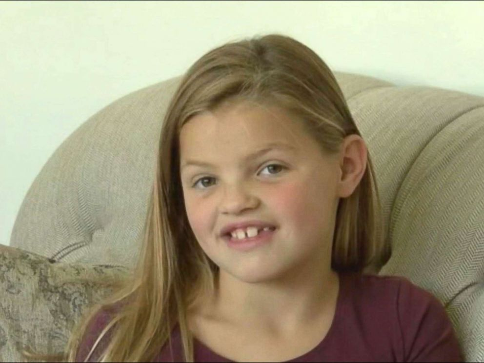 PHOTO: A 7-year-old girl called 911, saving her 1-year-old sister who fell in the pool.