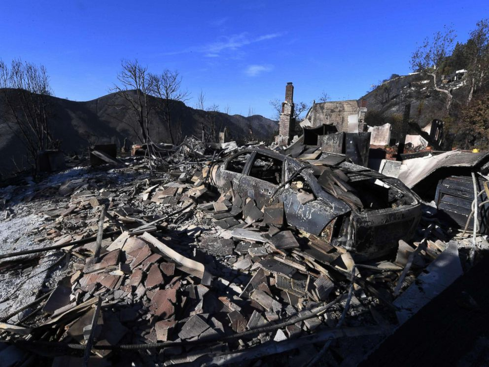 PHOTO: A burnt out house and car are seen after the Skirball wildfire swept through the exclusive enclave of Bel Air, Calif., Dec. 7, 2017.
