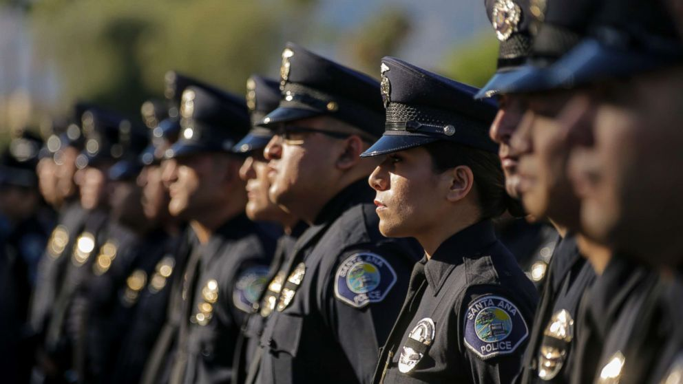 """Santa Ana police officers lined-up to get in for memorial services for Palm Springs police fallen Officers Lesley Zerebny and Jose """"Gil"""" Vega takes place, Oct. 18, 2016, at Convention Center in Palm Springs. Officers Vega and Zerebny were gunned down Oct. 8 after responding to a family disturbance call at a Palm Springs residence."""