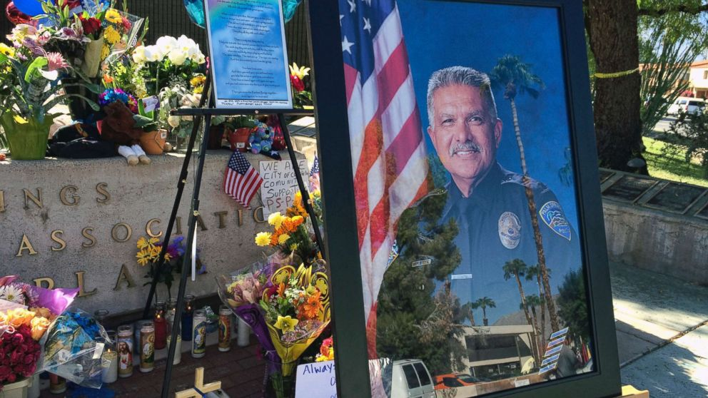 """A photo of Palm Springs Police Officer Jose """"Gil"""" Gilbert Vega is seen at a memorial for Vega and police officer Lesley Zerebny in front of the police station in Palm Springs, Calif., Oct. 10, 2016."""