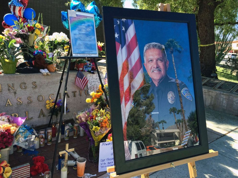PHOTO: A photo of Palm Springs Police Officer Jose Gil Gilbert Vega is seen at a memorial for Vega and police officer Lesley Zerebny in front of the police station in Palm Springs, Calif., Oct. 10, 2016.