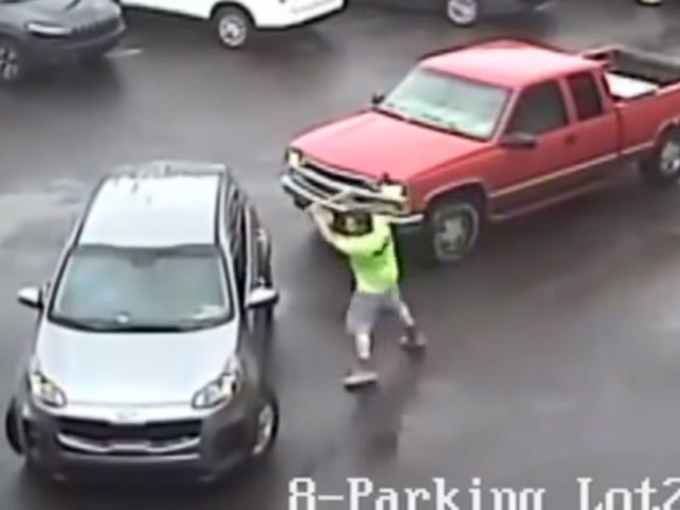 Caught on camera: man attacks SUV with sledgehammer