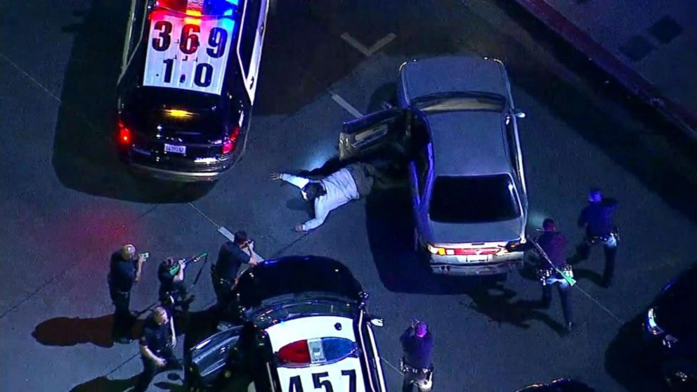 PHOTO: An image made from aerial video shows the driver in a slow-speed police chase in the Los Angeles area lying on the ground after exiting the car on May 31, 2018.