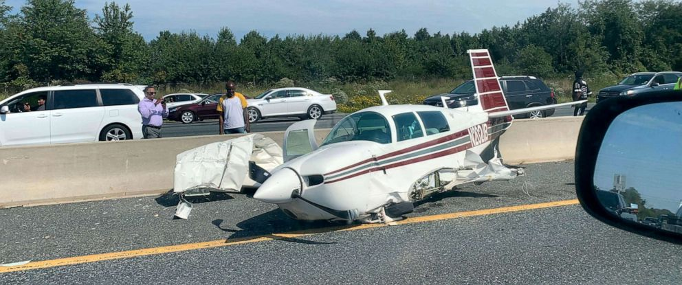 PHOTO: A small plane made an emergency landing on a highway in Bowie, Md., Sept. 12, 2019, crashing into a car and injuring four people.