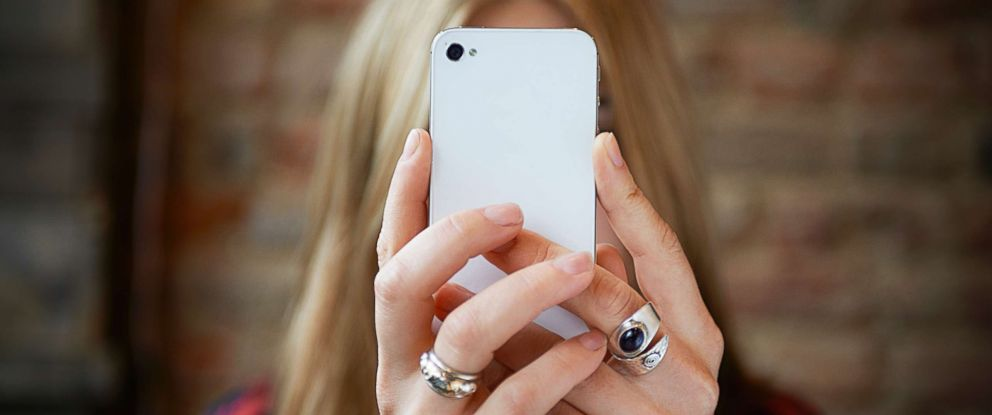 PHOTO: A woman takes a selfie with a cell phone in this undated stock photo.