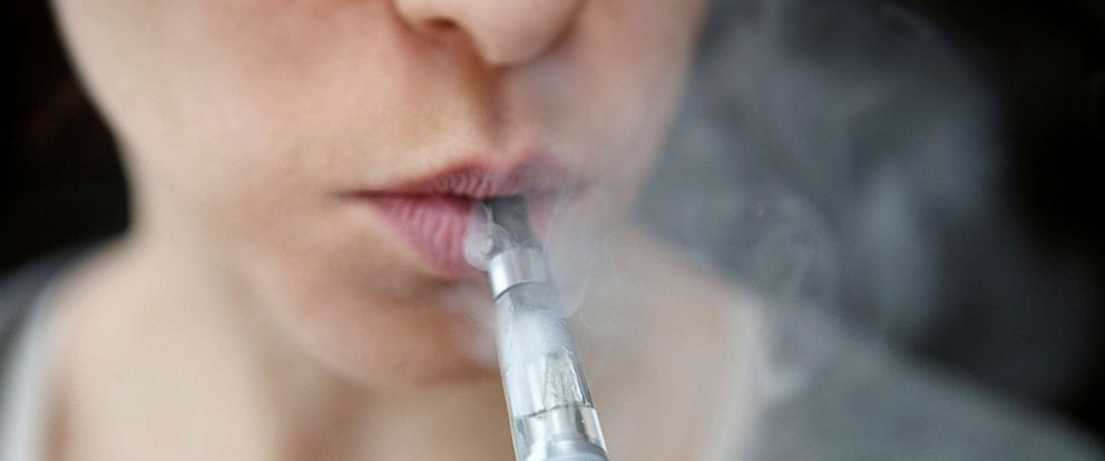 PHOTO: In this undated stock photo shows a person smoking an electronic cigarette.