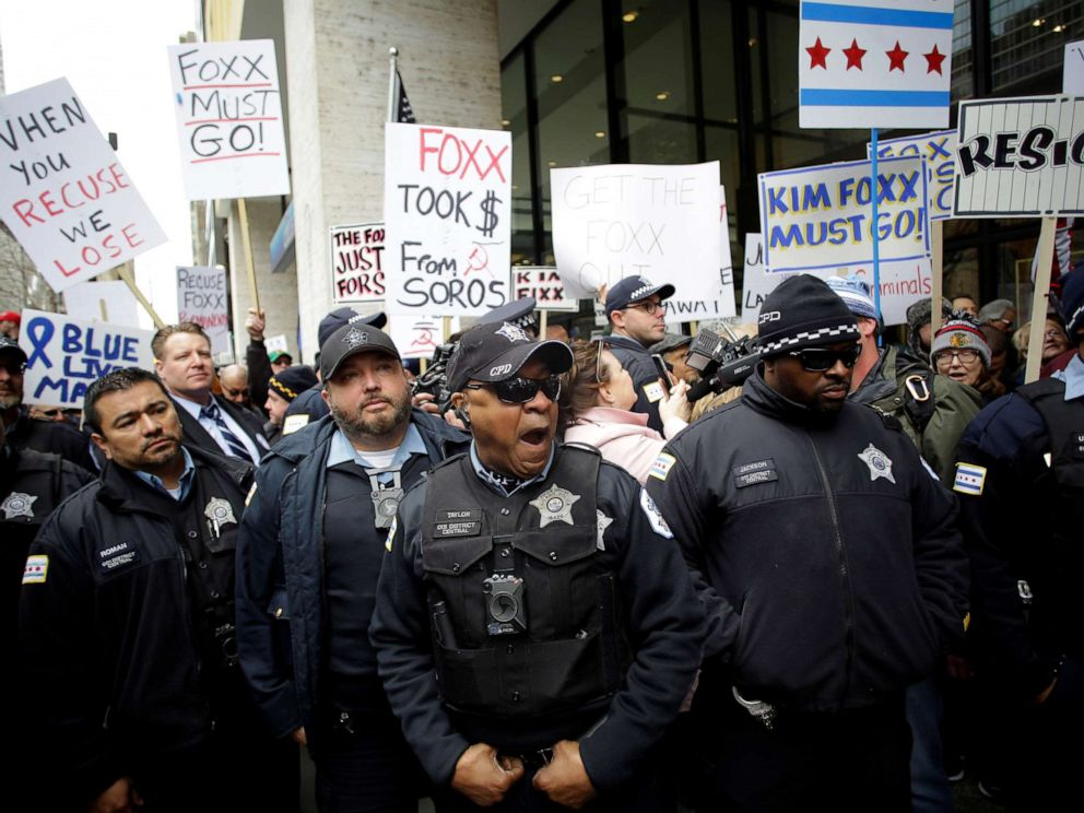 PHOTO:Chicago police officers stand in front of Fraternal Order of Police supporters protesting the handling of the Jussie Smollett case by the States Attorney Kim Foxx in Chicago, April 1, 2019.